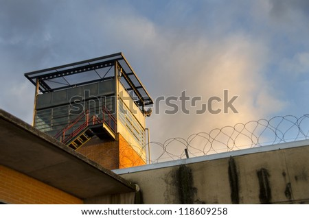 Prison tower in cloudy sunset