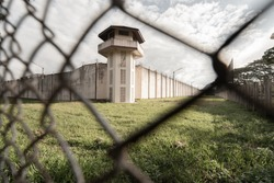 Prison with iron fences.Prison or jail is a building where people are forced to live if their freedom has been taken away.Prison is the building use for punishment prisoner.