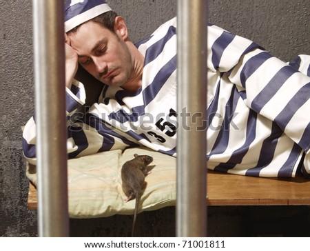 Prisoner in a prison cell.