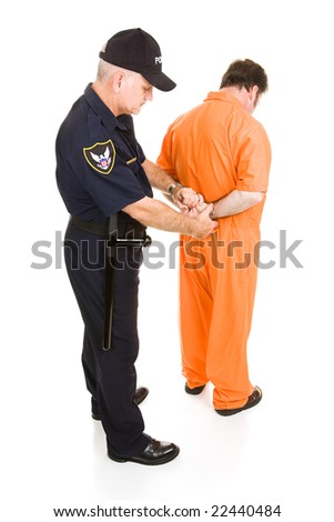 ... in orange jumpsuit is being handcuffed by police officer. Full body