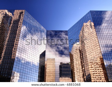 Pristine image of city buildings against a perfect blue sky. If you look closely you can also see the moon