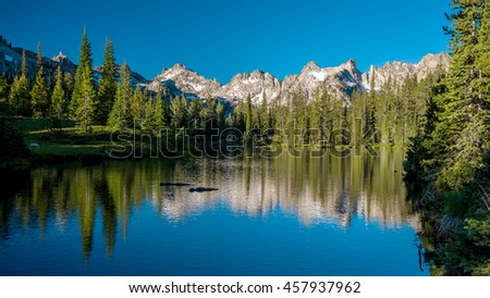Pristine lake with lake reflection and a little snow #457937962