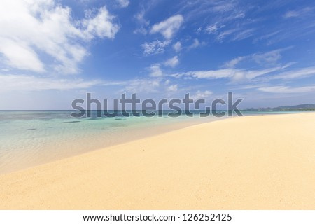 Pristine sandy beach and clear turquoise waters on a sunny, calm day. Sunset beach on Ishigaki Island, Okinawa prefecture, Japan.