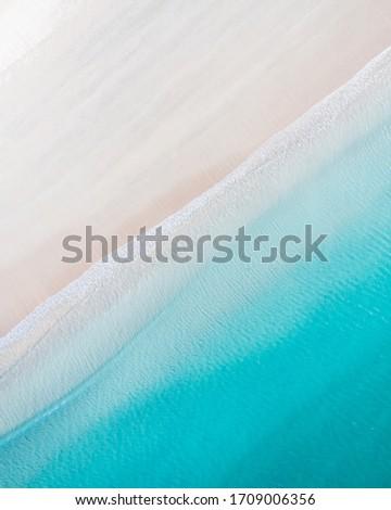 Pristine white sand beach and blue ocean