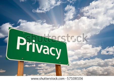 Privacy Green Road Sign with Dramatic Clouds, Sun Rays and Sky.