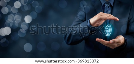 Privacy policy and security concepts. Protect your individuality in business. Businessman with protective gesture and fingerprint in hands. Wide banner composition with bokeh in background.