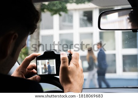 Private Detective Spying. Investigation And Surveillance With Camera ストックフォト ©