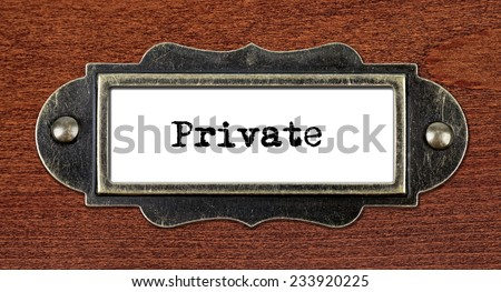 Private - file cabinet label, bronze holder against grunge and scratched wood