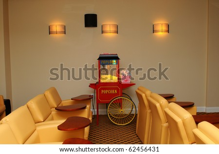 Private Home Theater With Plush Seats And Popcorn Machine Stock ...