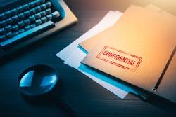 Private investigator desk with confidential envelopes