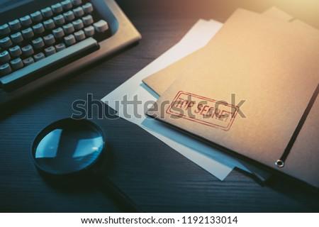 Private investigator desk with top secret envelopes Stock photo ©