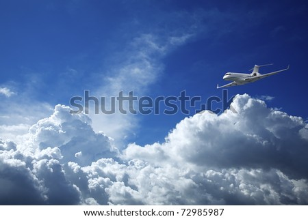 Private jet aircraft in a blue sky