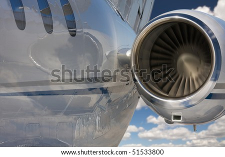 Private Jet and Engine Abstract Over Clouds and Sky.