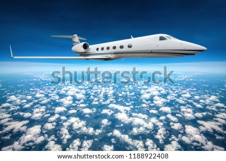 Private jet flying on a high altitude above the sky