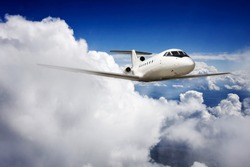 Private jet plane in the blue sky.