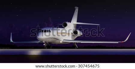 Private jet taxiing in the dark