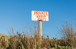 Private Keep Out warning sign in rural remote area