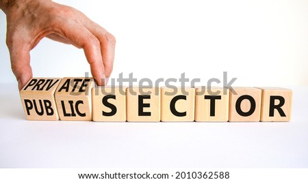 Private or public sector symbol. Businessman turns cubes and changes words 'public sector' to 'private sector'. Beautiful white background, copy space. Business, private or public sector concept. Stock foto ©