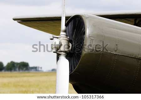 Private propeller-driven airplane over blurry background