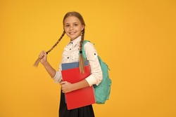 Private schooling. Teen with backpack. Cute smiling schoolgirl. Girl little schoolgirl carry backpack. Pupil with long braids going to school. Totally ready. Schoolgirl daily life. School club