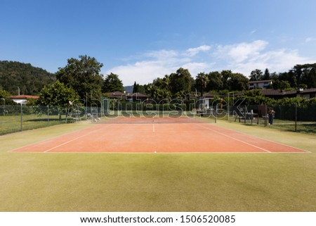 Private tennis court on a beautiful sunny summer day. Nobody inside #1506520085