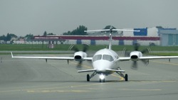 Private turboprop airplane taxiing at the airport