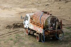 Private Water Tank Truck Car. Rust tank .