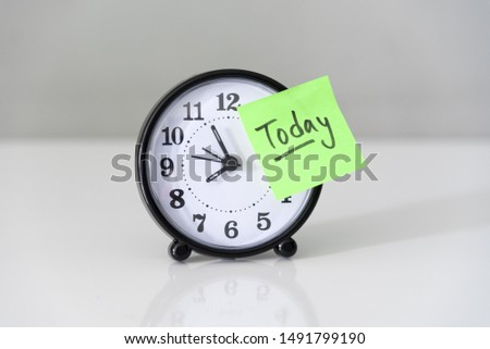 Proactive and beginning for action concept, handwriting word Today on green sticky paper over alarm clock with white wall background. #1491799190