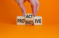 Proactive and productive symbol. Businessman turns cubes and changes the word 'productive' to 'proactive'. Beautiful orange background, copy space. Business, proactive and productive concept.