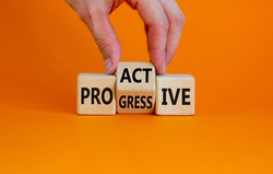 Proactive and progressive symbol. Businessman turns cubes and changes the word 'progressive' to 'proactive'. Beautiful orange background, copy space. Business, proactive and progressive concept.