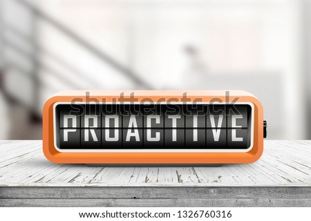 Proactive sign in the shape of a retro device on a wooden desk in a room #1326760316