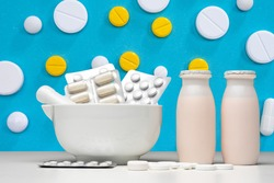 Probiotics bacteria. Table for manufacture of food additives. Food supplements with Probiotics bacteria. Medicine and probiotic bottles are side by side. Biologically active additives. Microorganisms