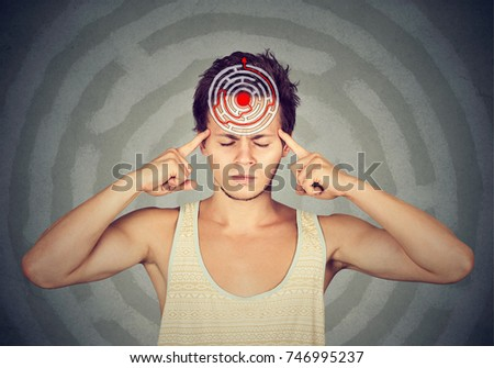 Problem solution concept. Young puzzled man isolated on gray wall background