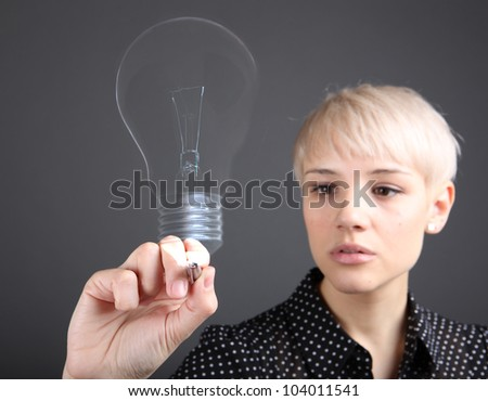 Problem solving concept - business woman drawing bulb