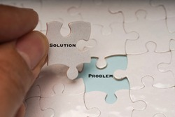 Problem solving or solution concept. Problem and solution wordings on puzzle pieces