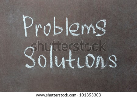Problems and solutions written with chalk on school blackboard