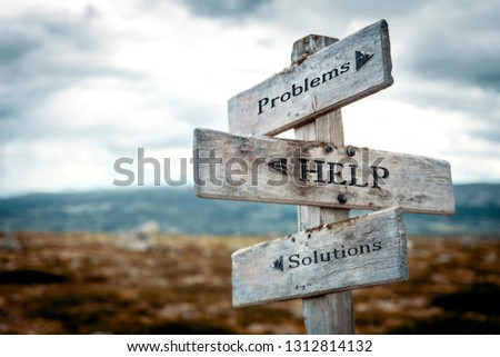 Problems, help, solutions signpost in nature. Rustic, wooden, wilderness, path, help, trouble, solution concept. #1312814132