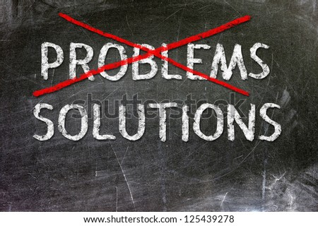 Problems Solutions handwritten with white chalk on a blackboard.