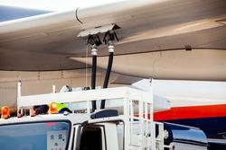 Process of aircraft (airplane) refueling closeup