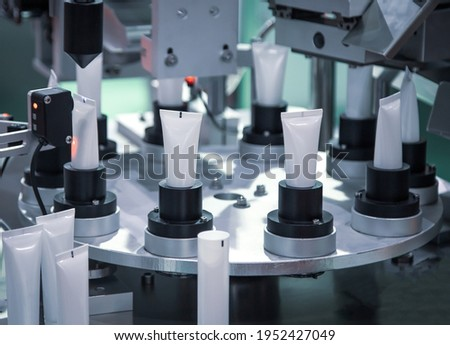 Process of automatic cosmetic tubes filling and sealing machine. Pharmaceutical industry Сток-фото ©