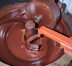 process of conching and refining chocolate in artisan small machine