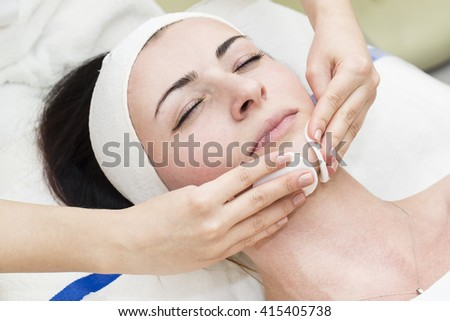 process of female massage cosmetic mask in a beauty salon #415405738