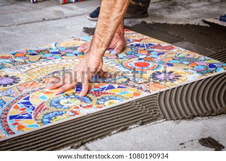 process of laying floor ceramic tiles, installation of tiles on the glue #1080190934