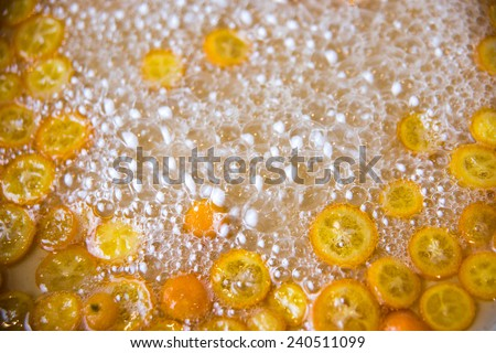 Process of Making Candies Kumquat Oranges in Sugar Water on Stove