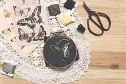 Process of making handmade embroidery. Hobby. Sewing tools. Remote home work. Swallowtail butterfly.
