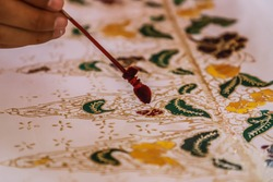 Process of making Thailand batik. It's a handmade artwork and one of the country's heritage, produced by technique of wax-resist dyeing applied to fabric.