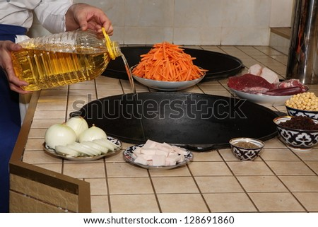 Process of preparation of rice with vegetables and meat: an onions, fat and meat vegetables and spices on a finishing table