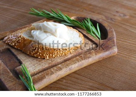 processed cheese bread on a wooden background