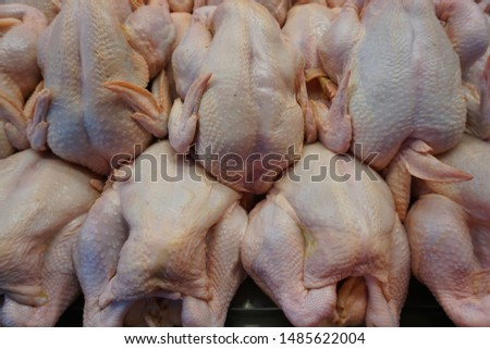 processed raw chicken at a wet market  #1485622004