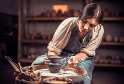 Processing clay ware and making dishes, process. Ceramics of handwork and clay ware on the potter's wheel.